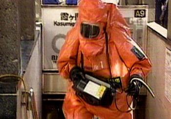 person in poison protected outfit